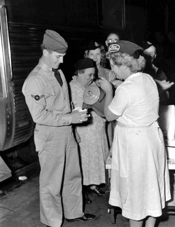 6-2 Free coffee and other items were distributed to troops passing through Lima.