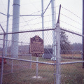Marker 11-8 seeting, fenced in beneath water tower