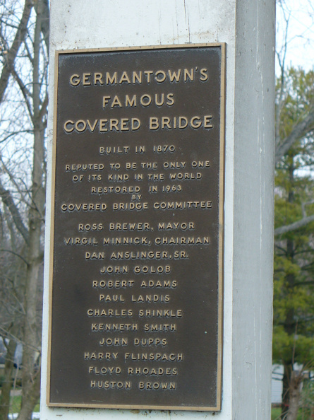 1-57 Restoration committee plaque on bridge