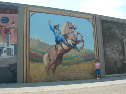 8-73 A fan of Roy Rogers visits his mural.