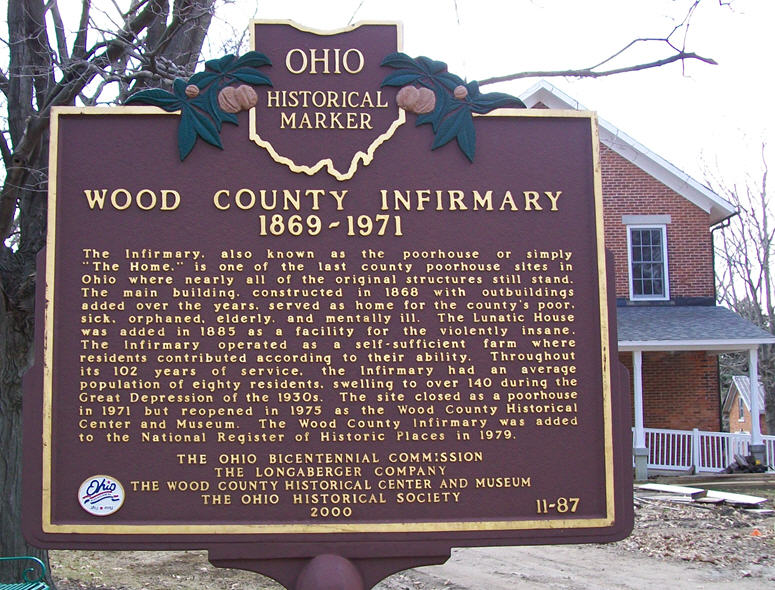 11-87 Historic Marker with lunatic house in the back ground